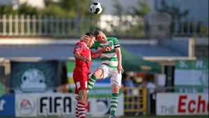Shamrock Rovers' Conor Kenna and Mark O'Sullivan of Cork City in an aerial battle for the ball