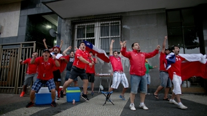 Chile fans rejoiced at their team leading Spain 2-0 just before the half
