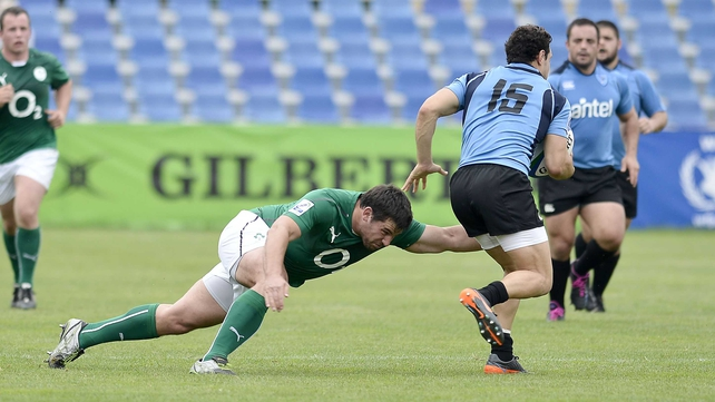 Paddy Butler, who scored two tries, tackles Jeronimo Etcheverry of Uruguay