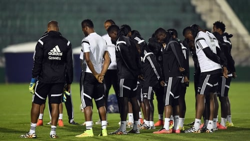 Nigerian players observe a moment of silence before training in honour of the victims of the bomb