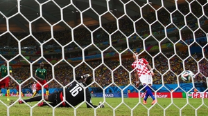 Mandzukic became the first Croatian to score two goals in a World Cup match at 73'