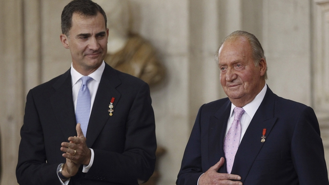 Prince Felipe of Spain and King Juan Carlos of Spain attend the official abdication ceremony at the Royal Palace last night