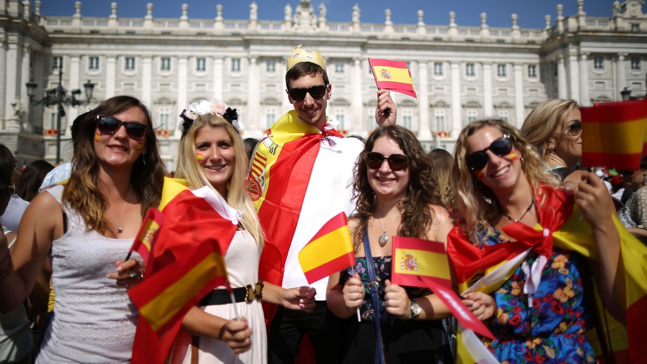 Well-wishers gather at Spain's Royal Palace in Madrid, prior to the coronation ceremony for King Felipe