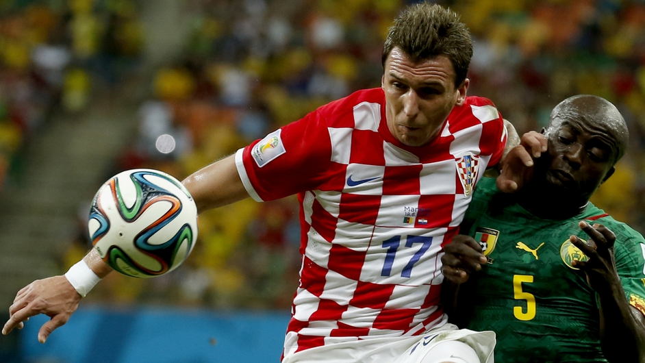 Croatia's Mario Mandzukic vies with Dany Nounkeu of Cameroon in a World Cup group A preliminary round match at the Arena Amazonia in Manaus, Brazil
