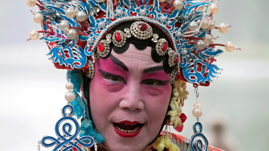 An actor in Peking opera-style costume performs in Beijing, China