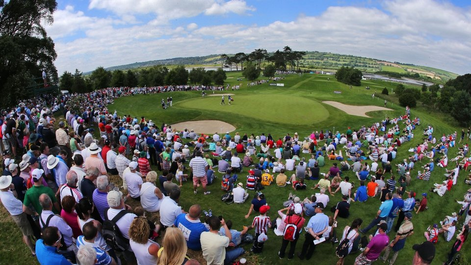 Large galleries watching Graeme McDowell, Paul Casey and Shane Lowry on the par 3 7th on Day One