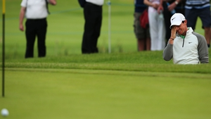 Rory McIlroy reacts after a bunker shot on the 11th during Day One