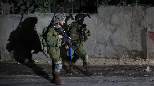Israeli soldiers during a night raid on the West Bank village of Arura