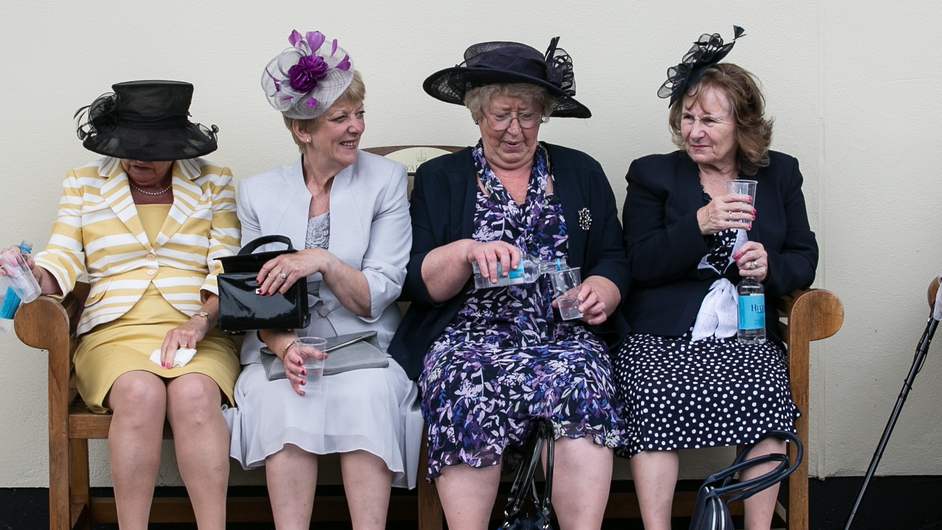 Racegoers take a break on Ladies Day at the Royal Ascot Racecourse, London