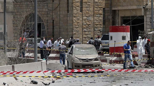 Lebanese security forces inspect the site of a suicide attack which targeted an army checkpoint