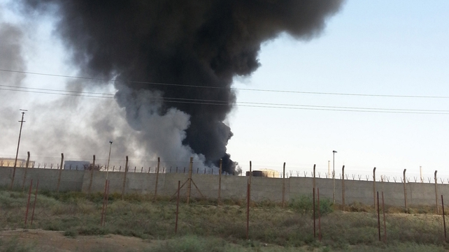 Smoke rises from the Baji oil refinery in northern Iraq