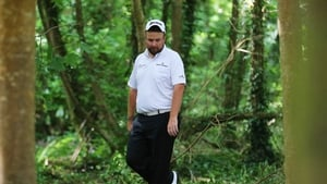 Shane Lowry searches in vain for his ball on the 18th on day two