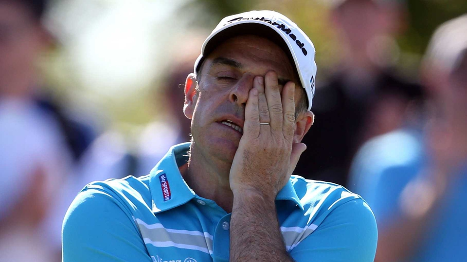 Paul McGinley reacts on the 14th green during day two