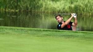 England's Robert Rock birdies the 14th from a bunker during the second round