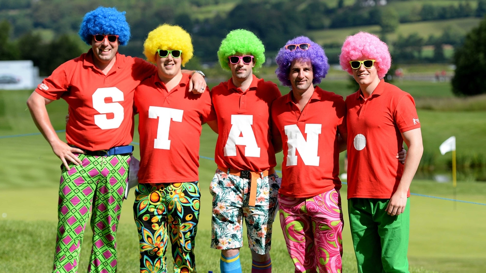 Golf fans dressed in colourful clothes for 'Wacky Trousers Day' during the second round...