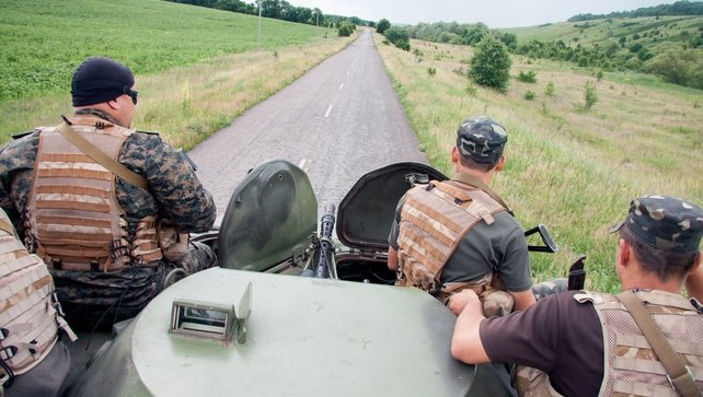 Ukrainian troops patrol an area near the border of Ukraine with Russia outside Kharkiv