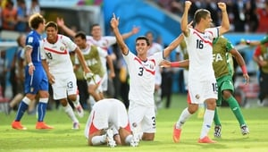 Costa Rican players celebrate after defeating Italy 1-0 to reach the second round of the World Cup in Brazil