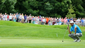 Graeme McDowell lines up a putt on day three