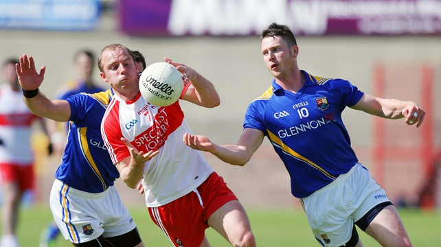 Derry's Sean Leo McGoldrick in action against Longford's Michael Quinn and Aidan Ro