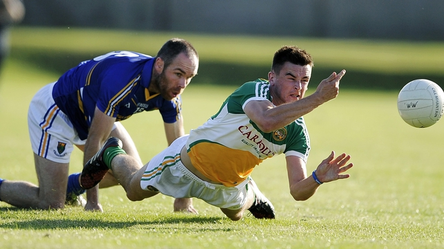 Offaly's Eoin Carroll with Patrick McWalter of Wicklow in Aughrim