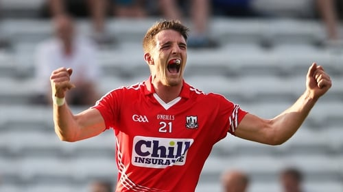 Cork's Aidan Walsh celebrates scoring a point during the final moments of the match