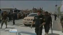 Shia militia members parade through Iraqi captial