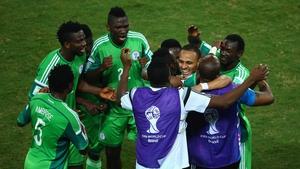 Nigeria's players congratulate match-winner Peter Odemwingie