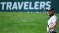 Moore takes slim lead at Travelers