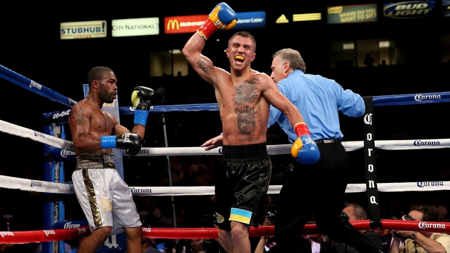 Vasyl Lomachenko celebrates after the final bell against Gary Russell Jr.