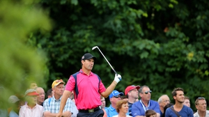 Padraig Harrington watches his tee shot go into the water on day three