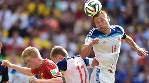... which saw play continuing at the same lacklustre level as before. Here, Russia defender Vasily Berezutskiy clears the ball away after a drab Belgium attack