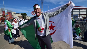 The Algeria fans were not fazed by the mysterious South Korean mascots afoot