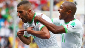 Slimani (L) celebrated creating the early lead
