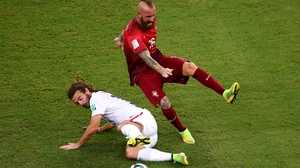 At 16' USA defender Kyle Beckerman made a messy - and malicious looking - tackle on Portugal midfielder Raul Meireles. Beckerman somehow escaped a booking, while his victim had to leave the pitch after the crude play