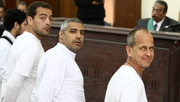 Baher Mohamed (L) Mohamed Fahmy (C) and Peter Greste (R) were accused of operating without a press license and broadcasting material harmful to Egypt