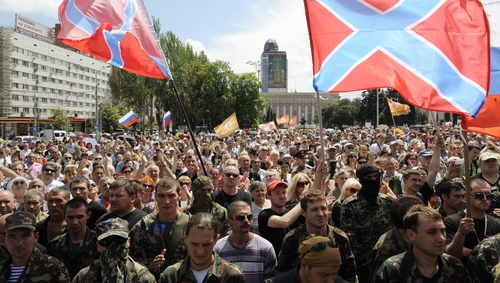Pro-Russian militants take the military oath of allegiance to the so-called People's Republic of Donetsk