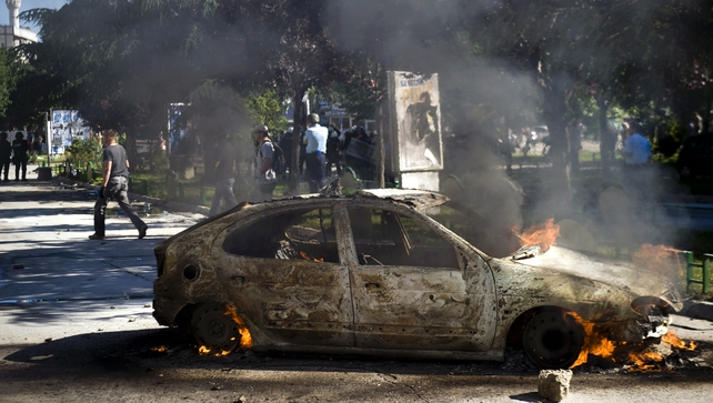 A vehicle burns during clashes between riot-police and protesters  in the divided town of Mitrovica