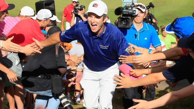 Kevin Streelman celebrates with fans after winning the Travelers Championship