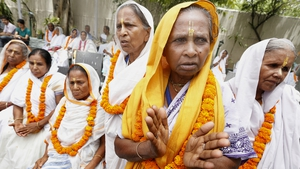 Widows participate in a function in New Delhi, India, to mark International Widows Day