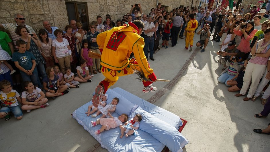 A man representing the devil leaps over babies during the festival of El Salto del Colacho (the devil's jump) in Castrillo de Murcia, Spain