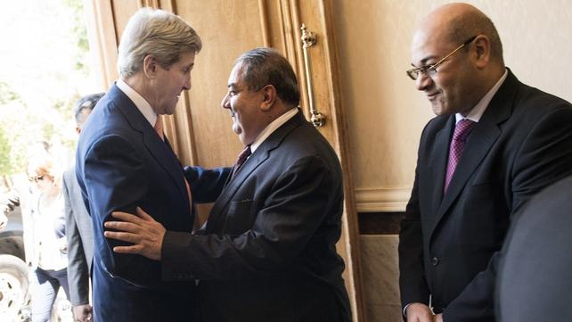 Iraqi Foreign Minister Hoshyar Zibari greets US Secretary of State John Kerry