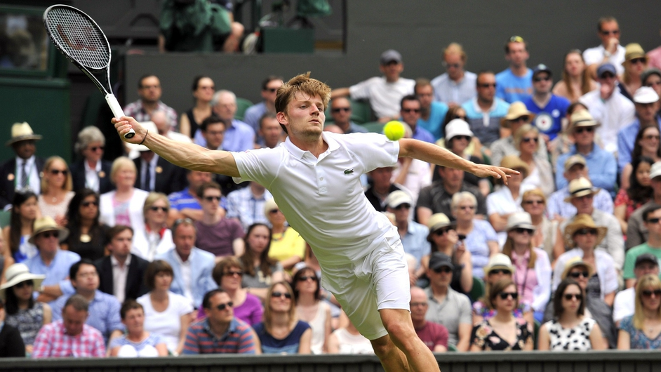 Belgium's David Goffin returns to Britain's Andy Murray during their men's singles first round match