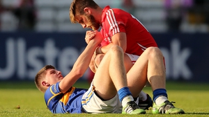 Cork's Eoin Cadogan consoles Steven O'Brien of Tipperary after a brave effort from the Premier County ended in defeat