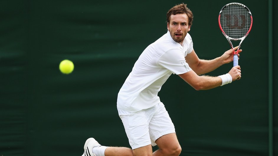 Ernests Gulbis plays a backhand during his match against Estonia's Jurgen Zopp