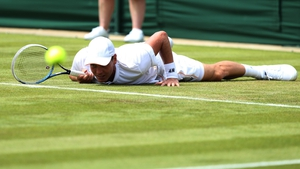 Czech Republic's Tomas Berdych slips during a game against Romania's Victor Hanescu