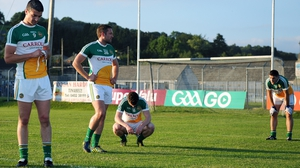 The end of the road - Offaly players dejected after defeat. Manager Emmet McDonnell resigned after the game