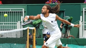 Dustin Brown of Germany returns to Marcos Baghdatis of Cyprus in their first round match
