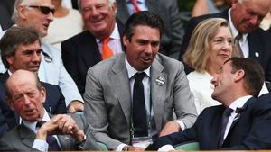 Wimbledon Chairman Philip Brook talks with former champion Michael Stitch