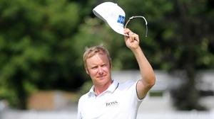 Mikko Ilonen salutes the crowd after winning the Irish Open