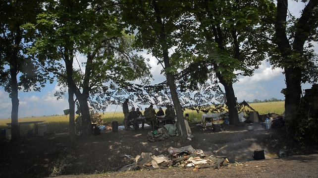 Ukrainian soldiers eat at a checkpoint near Slavyansk